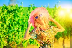 Margaret River Wine Tasting. Vineyard winery grape picking at sunset light. Harvest farming to make white wine. Happy caucasian woman at Wilyabrup in Margaret Royalty Free Stock Photo