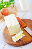 Margarine. And knife on wooden board Stock Photo