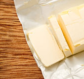 Margarine. Opened and cut fresh in closeup Stock Photos