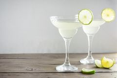 Margarita Ð¡ocktail. With lime and ice on wooden table, copy space. Classic Margarita Cocktail stock photography