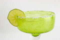 Margarita. With lime slice in a green glass Royalty Free Stock Photography