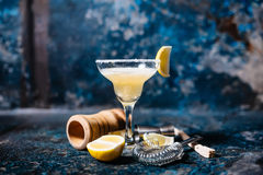Margarita alcoholic beverage, fancy cocktail with lime garnish and lemons Royalty Free Stock Images
