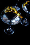 Margarita cocktail alcohol drink in glass with green olives Stock Photos