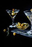 Margarita cocktail alcohol drink in glass with green olives Royalty Free Stock Image