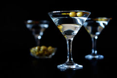 Margarita cocktail alcohol drink in glass with green olives Stock Images