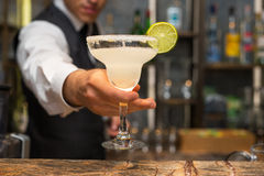 Margarita cocktail. Barman serving margarita cocktail, concept for cocktails and alcoholic drinks Stock Photography