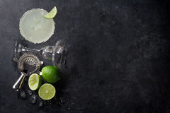 Margarita cocktail. On dark stone table. Top view with space for your text royalty free stock photos