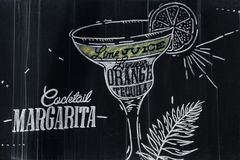 Margarita cocktail drawing with chalk on blackboard royalty free stock photo