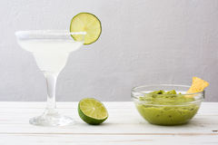 Margarita cocktail and guacamole on a white wooden table background Stock Photos