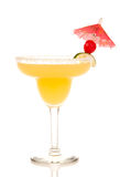 Margarita cocktail with lime cherry umbrella. Margarita cocktail in chilled salt rimmed glass with tequila, orange, apple, triple sec, juice, simple syrup and stock images