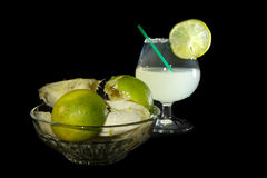 Margarita cocktail and a plate of squashed lime Royalty Free Stock Photography