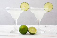 Margarita cocktail on a white wooden table background Royalty Free Stock Photos