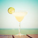 Margarita cocktail on the wooden pier. Concept of classic drink. Royalty Free Stock Photo