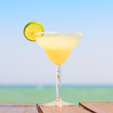 Margarita cocktail on the wooden pier. Concept of classic drink. Stock Photos