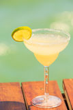 Margarita cocktail on the wooden pier. Concept of classic drink. Stock Image