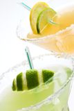 Margarita cocktails closeup. Closeup of Golden Margarita and Midori Margarita tequila cocktails garnished with lime and lemon wedges Stock Images