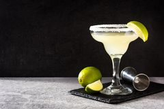 Margarita cocktails with lime in glass. On gray background. Copyspace stock images