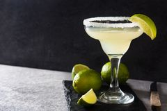 Margarita cocktails with lime in glass on gray background. Copyspace stock photos