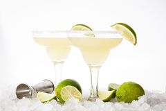 Margarita cocktails with lime in glass isolated on white background. Margarita cocktails with lime and ice in glass isolated on white background stock image