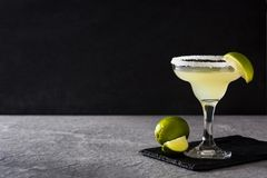 Margarita cocktails with lime in glass. On gray background. Copyspace royalty free stock photo