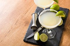 Margarita cocktails with lime in glass. On wooden table. Copyspace stock images