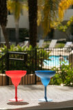 Margarita cups. Colorful plastic margarita cups by the pool Royalty Free Stock Images