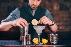 Margarita drink, alcoholic beverage, cocktail with lime garnish and lemons. Margarita drink, alcoholic beverage, fancy cocktail with lime garnish and lemons Royalty Free Stock Photography