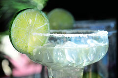 Margarita drink on bar. Margarita drink with slice of lime on bar counter Stock Photos