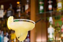 Margarita glass. Against the background of bar shelves stock photos