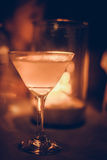 Margarita iced cocktail in martini glasses in front of the night bokeh lights on blurred candle background Royalty Free Stock Photography