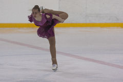 Margarita Kostenko de Rússia executa o programa de patinagem livre das meninas da classe V do ouro no campeonato nacional da pati Fotos de Stock