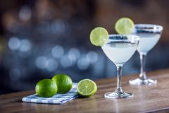 Margarita. Margatita alcoholic cocktail drink on barcounter in p. Ub or restaurant royalty free stock images