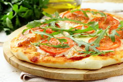 Margarita pizza with tomatoes and with arugula Stock Photography