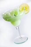 Margarita Splash. Lime margarita splashing with lemon wedge Stock Image