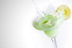 Margarita Splash. Lime margarita splashing with lemon wedge Stock Photo