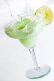 Margarita Splash. Lime margarita splashing with lemon wedge Stock Photos