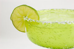 Margarita step three. Margarita with lime slice in a green glass royalty free stock images