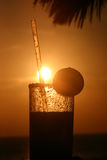 Margarita Sunset. A tropical sunset silhouetting a frosty margarita glass royalty free stock photography