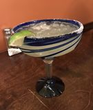 Margarita on the Rocks in a Blue Glass royalty free stock photo