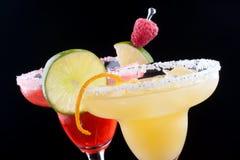 Margaritas da laranja e da framboesa imagens de stock