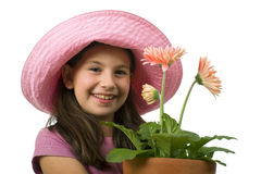 Margaritas rosadas de la chica joven fotos de archivo libres de regalías