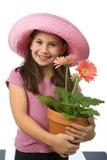 Margaritas rosadas de la chica joven imagenes de archivo