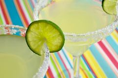Margaritas. Two margaritas on a brightly colored surface Stock Photos