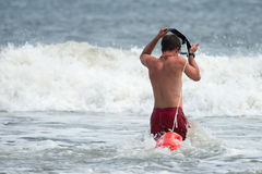 MARGATE CITY, NJ - AUGUST 8: Margate City Lifeguard running into the Atlantic Ocean to rescue a swimmer in distress Stock Photography
