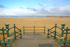 The Margate seafront with Margate Harbor Arm in the background, Margate, Kent, UK. The Margate seafront with Margate Harbor Arm in the background Royalty Free Stock Images