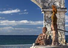 Margem maia de produção transversal de Cozumel México da mulher do guerreiro asteca do monumento fotografia de stock