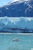 Margerie Glacier and boat. A small boat against the backdrop of the Margerie Glacier in Glacier Bay, Alaska Royalty Free Stock Photos