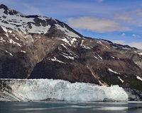 Margerie glacier and mountain with blue skies Royalty Free Stock Photography