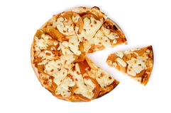 Margharita Pizza and Slice. A small Margharita pizza with a slice removed. Studio isolation royalty free stock image