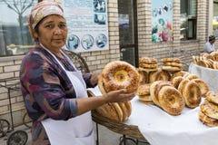 MARGILAN, UZBEKISTAN - AUGUST 24, 2018: National plain uzbek bread sold in the market - Margilan near Fergana, Uzbekistan. stock photo